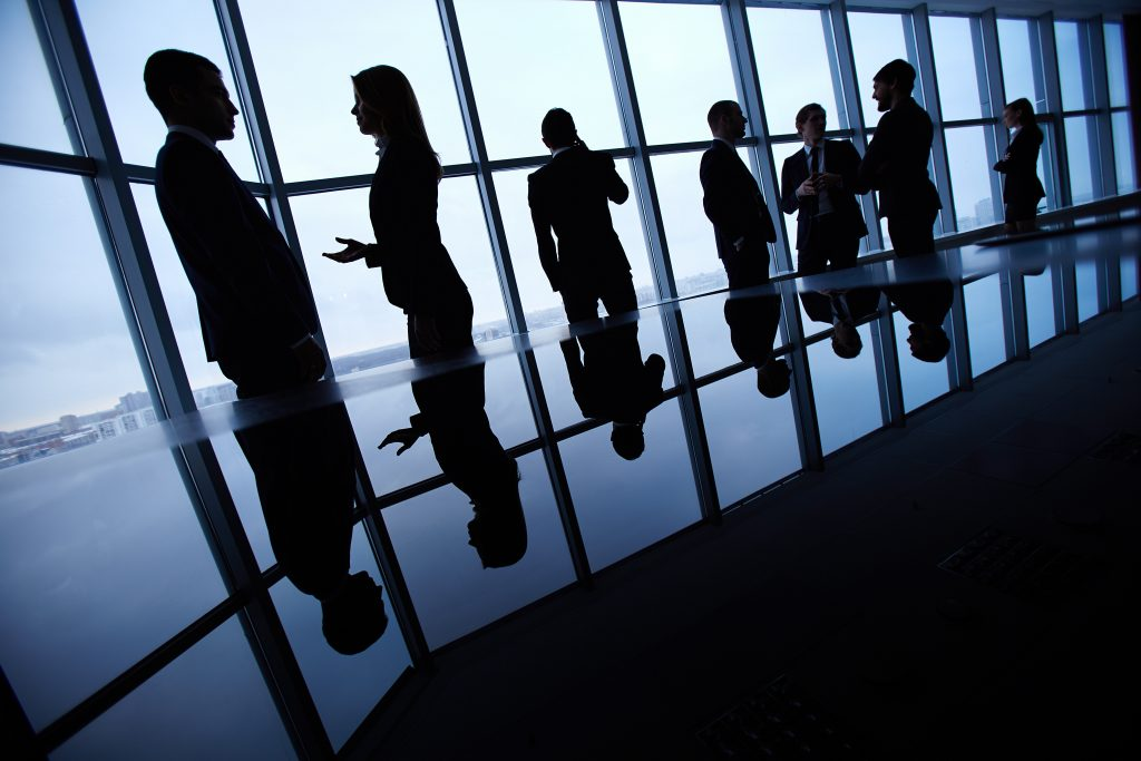 Business interaction in a boardroom